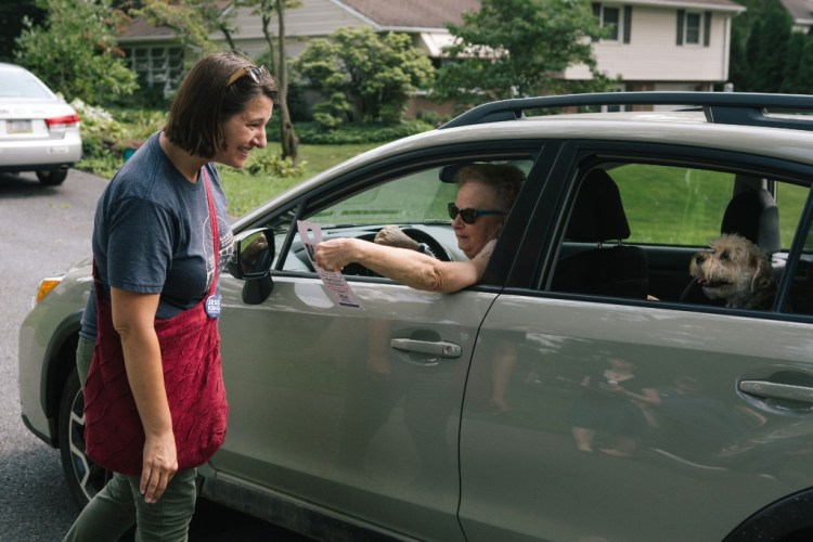 Congressional candidate Jess King speaks with Mount Joy resident P. Sinclair-Bairos while out canvassing in Mount Joy, Pennsylvania on Saturday, August 18, 2018. King, who lives in nearby Lancaster, is running for Congress in Pennsylvania's 11th District.(Michelle Gustafson for The Intercept)