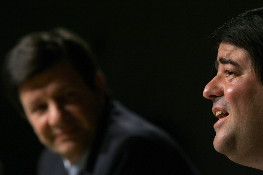Brazilian bankers Roberto Setubal (L), of Itau, listens to Pedro Moreira Salles, of Unibanco, as he speaks during a press conference announcing the merger of their institutions, in Sao Paulo, Brazil, on November 3, 2008. Brazil's Itau and Unibanco stated they were merging to create the biggest bank in Latin America, with combined assets of more than 260 billion dollars. Itau is currently the second largest private-sector bank in Brazil, and Unibanco is ranked fourth. AFP PHOTO/Mauricio Lima (Photo credit should read MAURICIO LIMA/AFP/Getty Images)