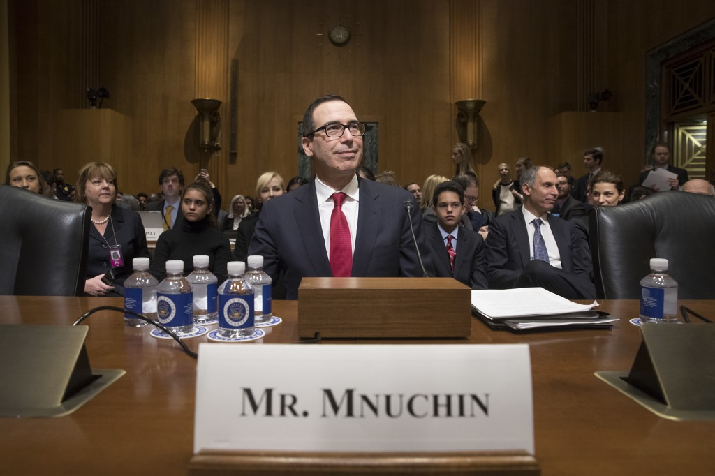 Treasury Secretary-designate Stephen Mnuchin arrives on Capitol Hill in Washington, Thursday, Jan. 19, 2017, to testify at his confirmation hearing before the Senate Finance Committee. Mnuchin built his reputation and his fortune as a savvy Wall Street investor but critics charge that he profited from thousands of home foreclosures as the chief of a sub-prime mortgage lender during the housing collapse. (AP Photo/J. Scott Applewhite)