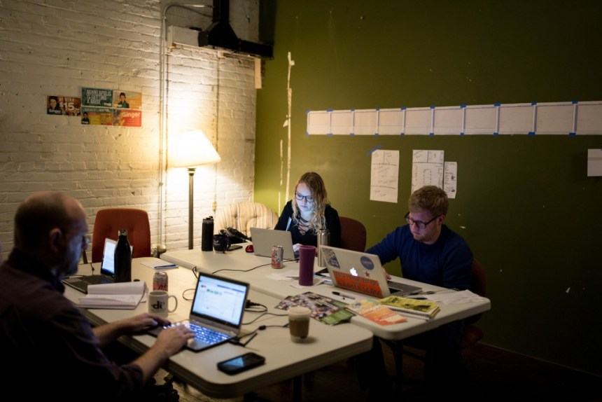 Kelly Bellin and Andy Moxley, right, work on Ginger Jentzen's campaign in the campaign headquarters on October 20, 2017 in Minneapolis, Minnesota.