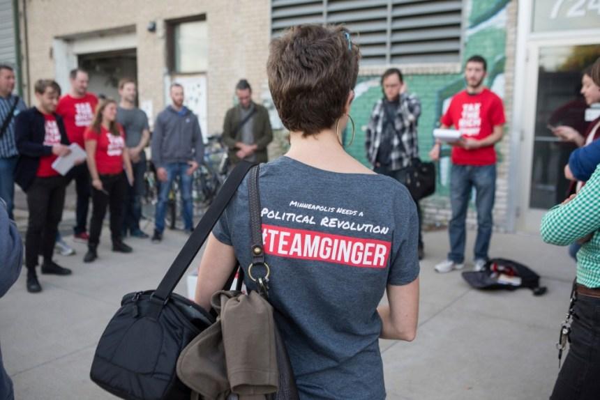 Volunteers for Ginger Jentzen's campaign meet before knocking on doors in Minneapolis, Minnesotaon October 20, 2017.