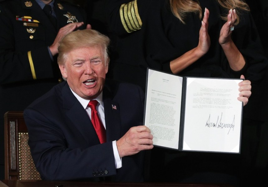 WASHINGTON, DC - OCTOBER 26:  U.S. President Donald Trump shows a presidential memorandum that he signed during an event highlighting the opioid crisis in the U.S. October 26, 2017 in the East Room of the White House in Washington, DC. Trump plans to authorize the Department of Health and Human Services to declare a nationwide public health emergency in an effort to reduce the number of opioid overdose deaths across the nation.  (Photo by Alex Wong/Getty Images)