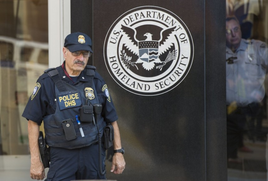 A police officer and a security officer look on at the US Immigration and Customs Enforcement (ICE)  office, part of the Department of Homeland Security (DHS),  in Washington DC on October 4, 2017. / AFP PHOTO / ANDREW CABALLERO-REYNOLDS        (Photo credit should read ANDREW CABALLERO-REYNOLDS/AFP/Getty Images)