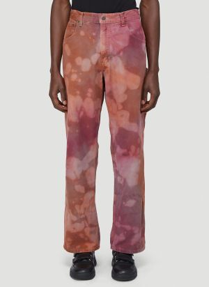 Stain Shade X Carhartt Tie-Dyed Carpenter Pants in Orange