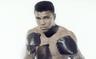 Muhammad Ali picture wearing boxing gloves