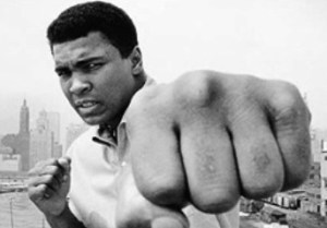 Picture of Ali showing the fist that stings like a bee.