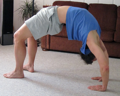 Freelance writer John Soares does the yoga back-bend: the wheel pose, chakrasana.