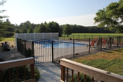 Vinyl and alumininum...a nice match! Shown here is a very nice pool enclosure using OnGuard's 54 inch Starling style aluminum fence in black with Illusions V300-6, six foot tall T&G privacy panels in their 'Mix and Match' Classic Beige and Classic White. Illusions vinyl fence is offered in a wide variety of styles, heights and colors and we carry all of them.