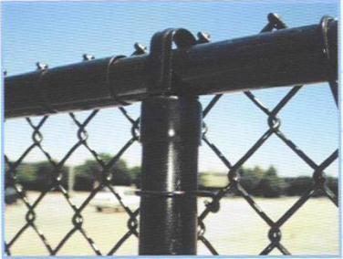 Black powder coated chain link fence framework with black vinyl clad mesh. Mesh is referred to as 'fabric' in the fence industry!