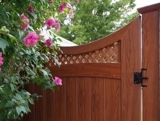 Scalloped top rail, arched mid rail small diagonal lattice topped gate. Be sure to visit the Illusions Vinyl Fence gate page to se all the gate styles.