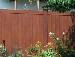 V300-6 - a six foot tall Illusions privacy fence panel in Rosewood wood grain vinyl finish.