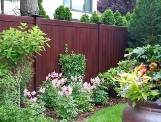 V300 T&G privacy fence sections in Mahogany wood grain vinyl by Grand Illusions.