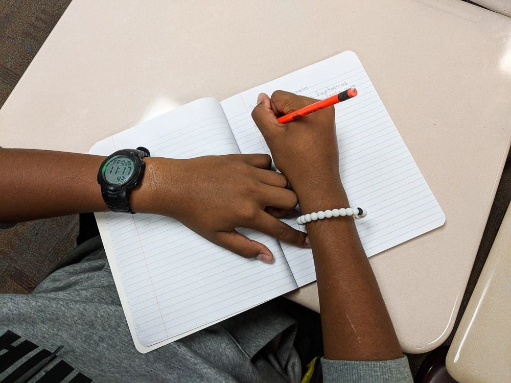 male student writing