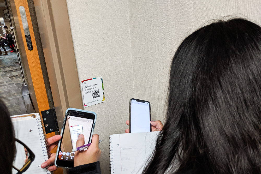 students do webquest in the hallway with task cards qr codes