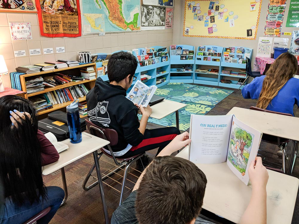 students reading in Spanish class