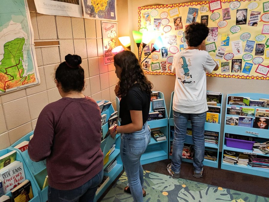 students in classroom library
