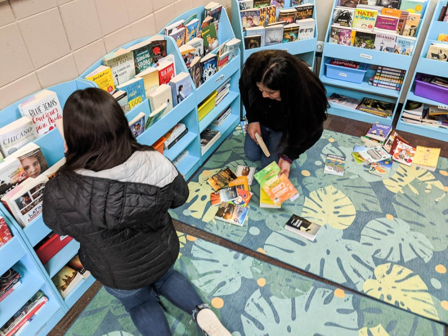 students and books in classroom