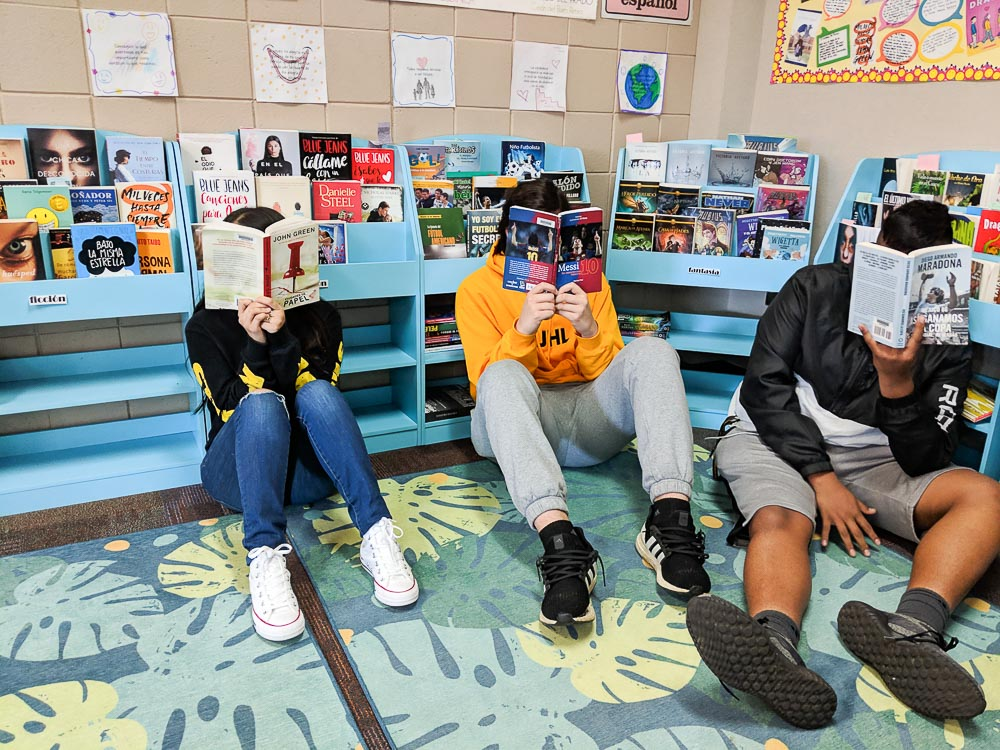 students reading books in classroom