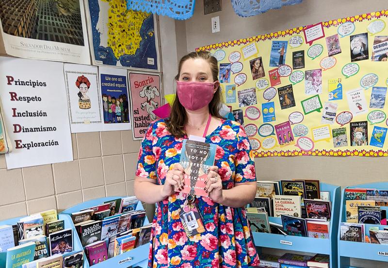 Spanish teacher with classroom library for FVR