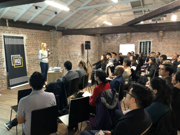 Female guest speaker talking to young professionals in a PDF event