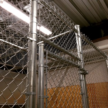 Chain Link Cage With An Angled Roof