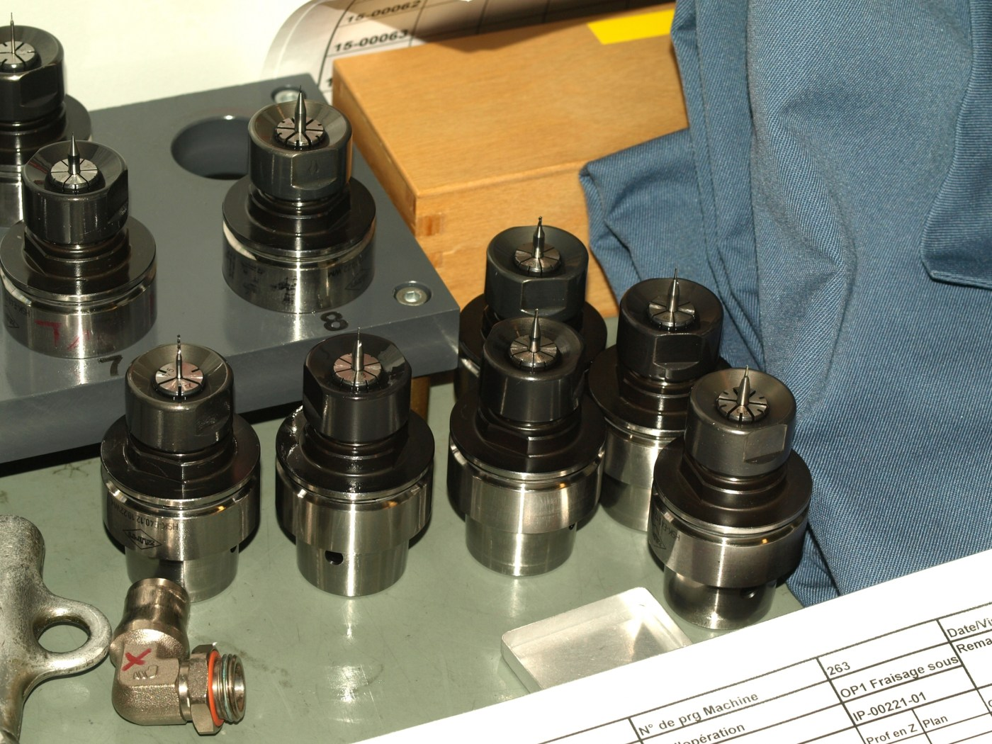 Drill bits used to mill watch hands on automated CNC machine