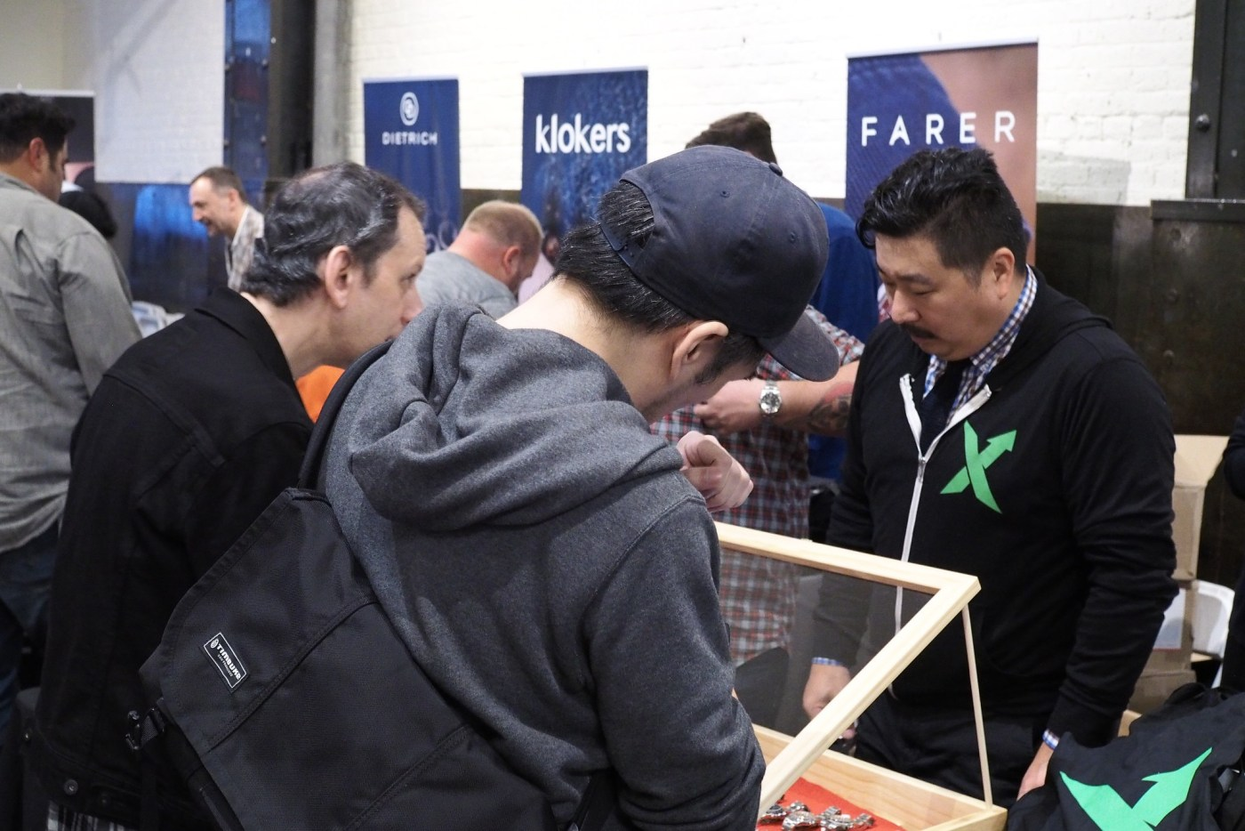 Visitors Checking out StockX watch stand