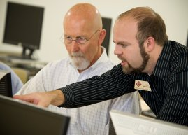 Professor Josh working with Faculty