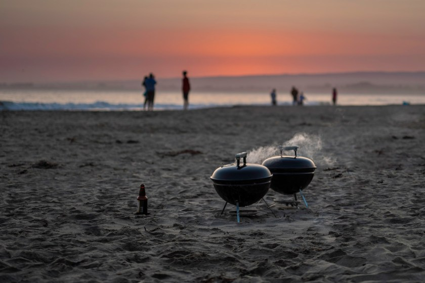 Photo of two grills on the beach
