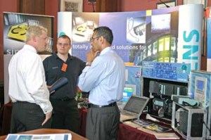 Delegates quiz exhibitors at the PROFIBUS Conference