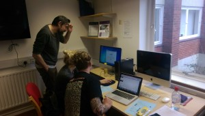 Chris Warne and two of the ma mentors, Jimmy and Kasia getting their heads around Padlet