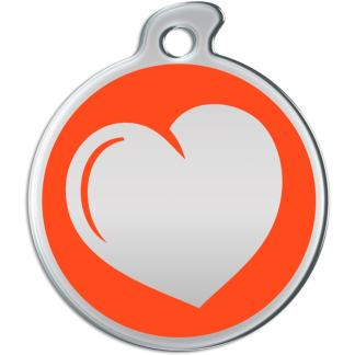Image of a round dog tag with  a metallic heart on an orange background.