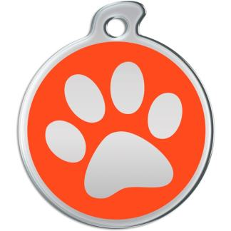 Image of a round dog tag with metallic paw on orange background.