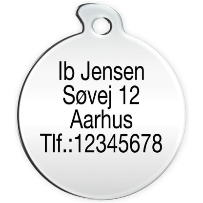 Round dog tag with 4 lines of text.