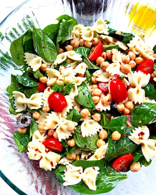 Pasta Salad with fresh veggies and chickpeas marinated in lemony greek vinaigrette