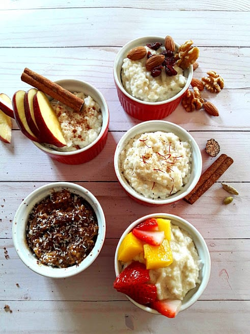 Classic Vegan Rice Pudding Served with 5 different toppings. The variety includes apple cinnamon, chocolate, fruit melody, Saffron, cardomom and dry fruits and nuts