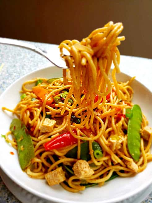 Chili Garlic Chinese Noodles twirling around fork. This delicious Profusioncurry recipe is spicy, delicious and easy