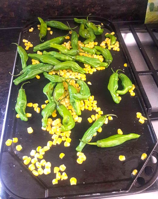 Stove top grill for charring the shishito peppers and corn