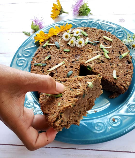 Cut slice of Vegan Zucchini Bread showing moist, fluffy and dense texture