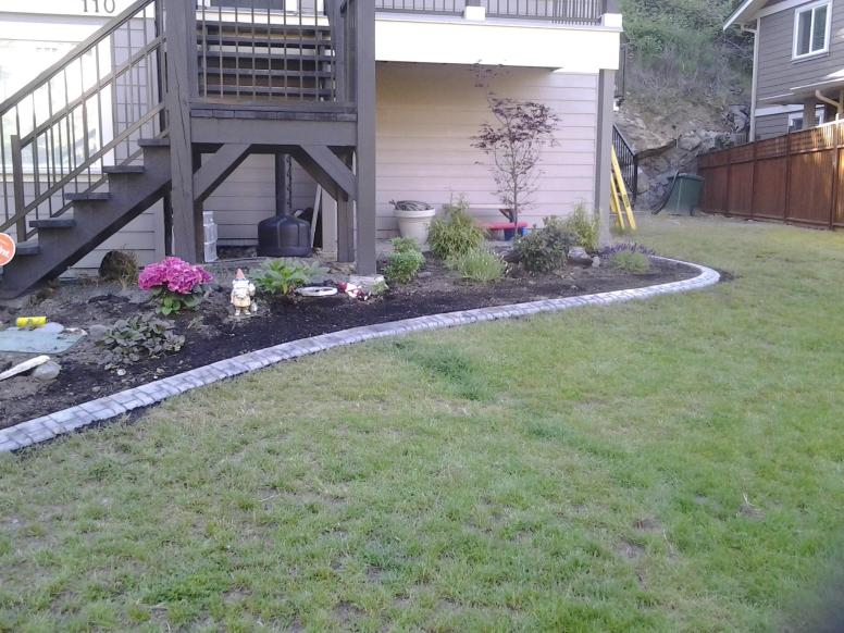 Landscape curbing and gardens