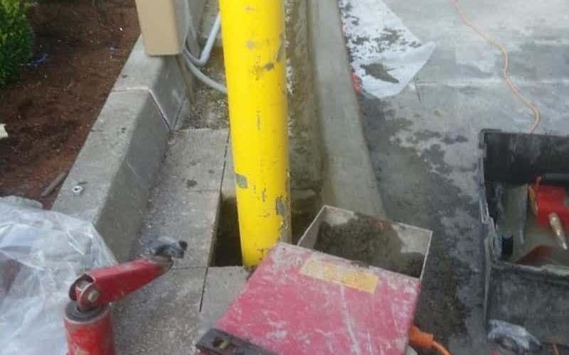 Curbing machine in progress.