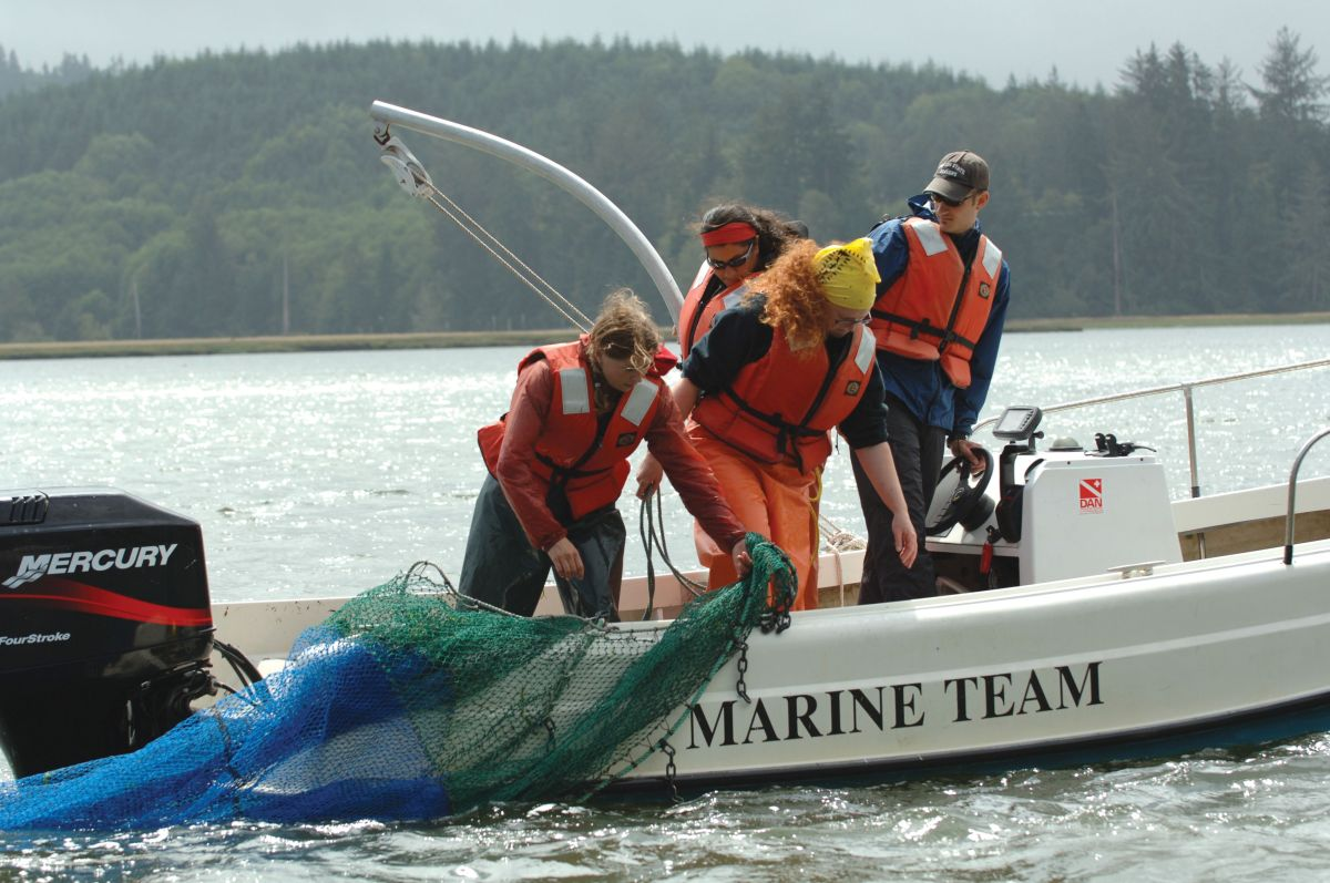 students work in Marine Team boat