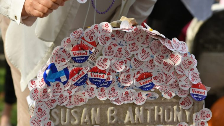 """The grave of women's suffrage leader Susan B. Anthony is covered with """"I Voted"""" stickers left by voters in the U.S. presidential election."""