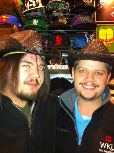 "This is so wrong. This is my fiance and his friend wearing cowboy hats. We joked they was the ""gay"" cowboys."