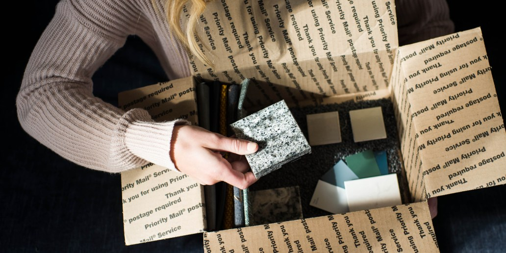 girl opening box of quartz samples