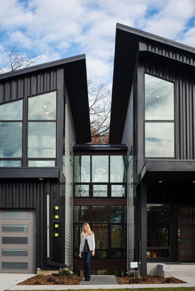 Kate Rumson standing in front of a luxury home in Minneapolis by Sustainable9