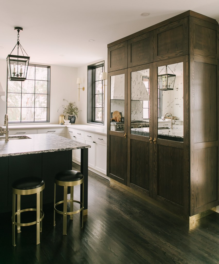 Wood cabinetry with mixed panels with mirror treatment. This kitchen is more traditional and classy.