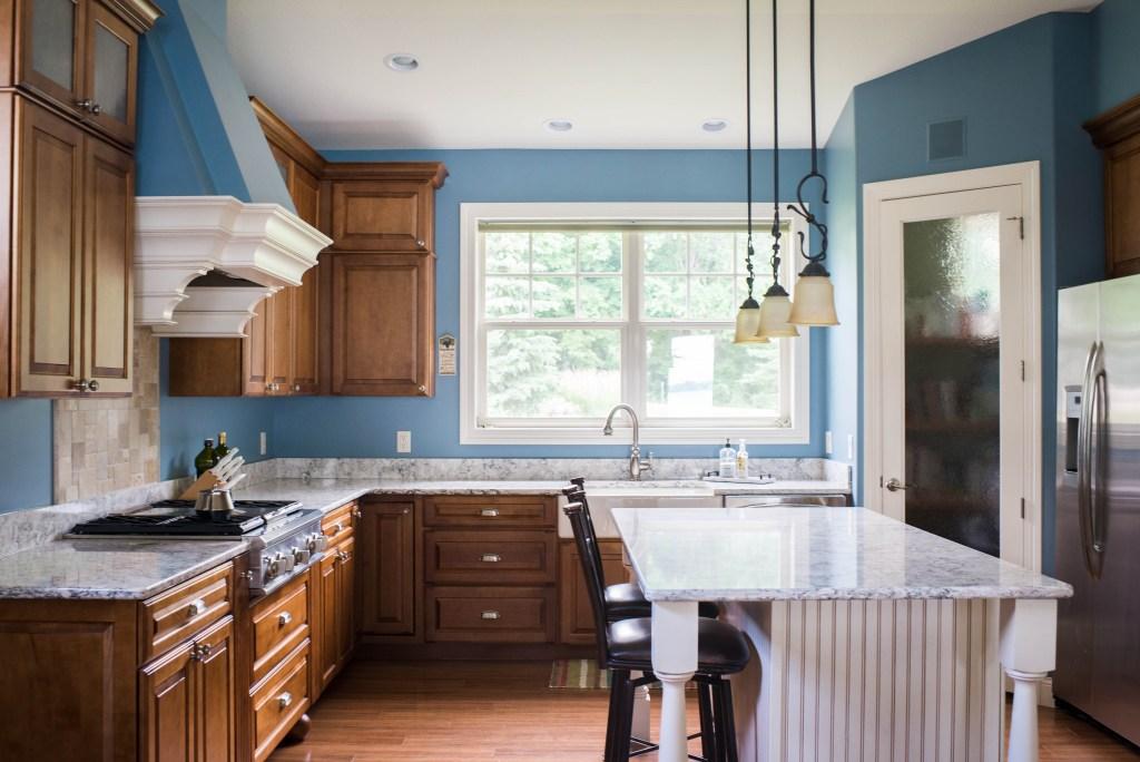 full image of kitchen with u-shape and large island