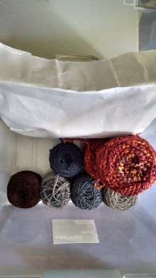 Project Bin: fiber for The Mood Scarf, Girl On Fire, Jasmine Cardigan (black yarn is in the white bag here) and Sweet November Shawl (not shown).