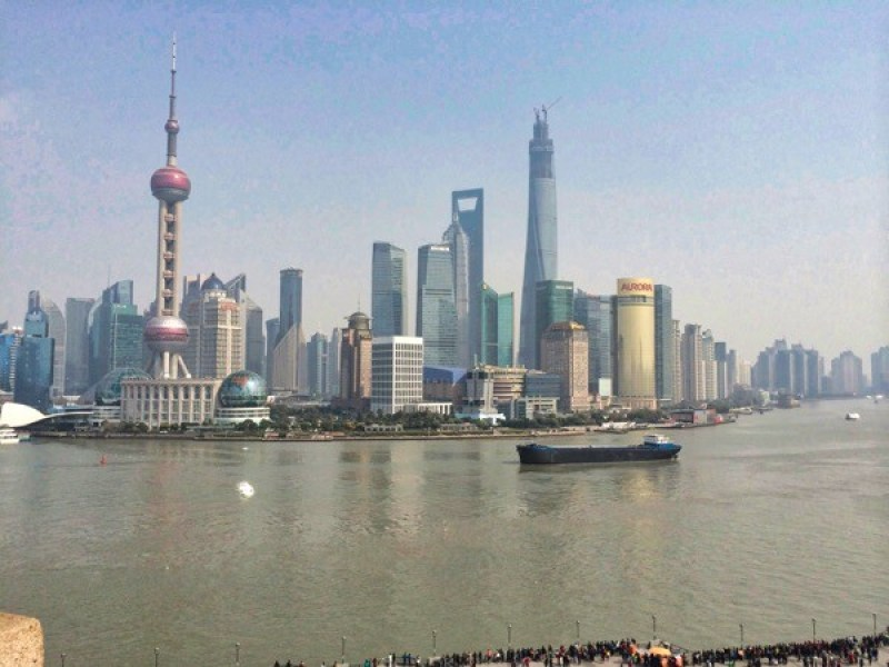 A barge at the bund in Shanghai passing Pudong CBD on the starboard side.